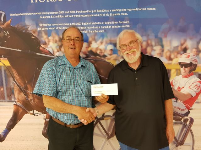 ed siefried receives cheque from Woolwich ag society